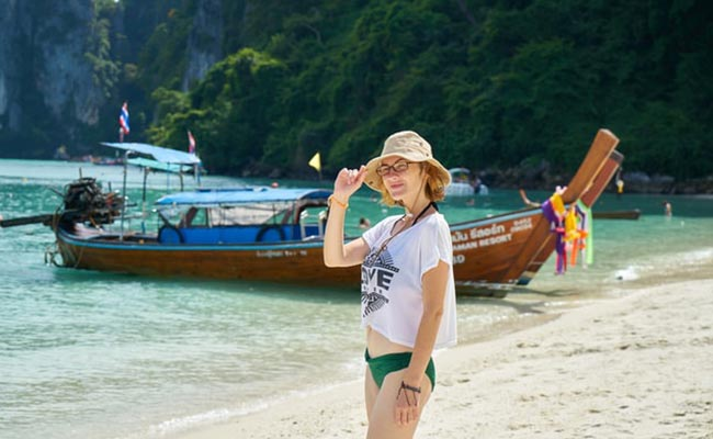 female-traveler-beach-thailand